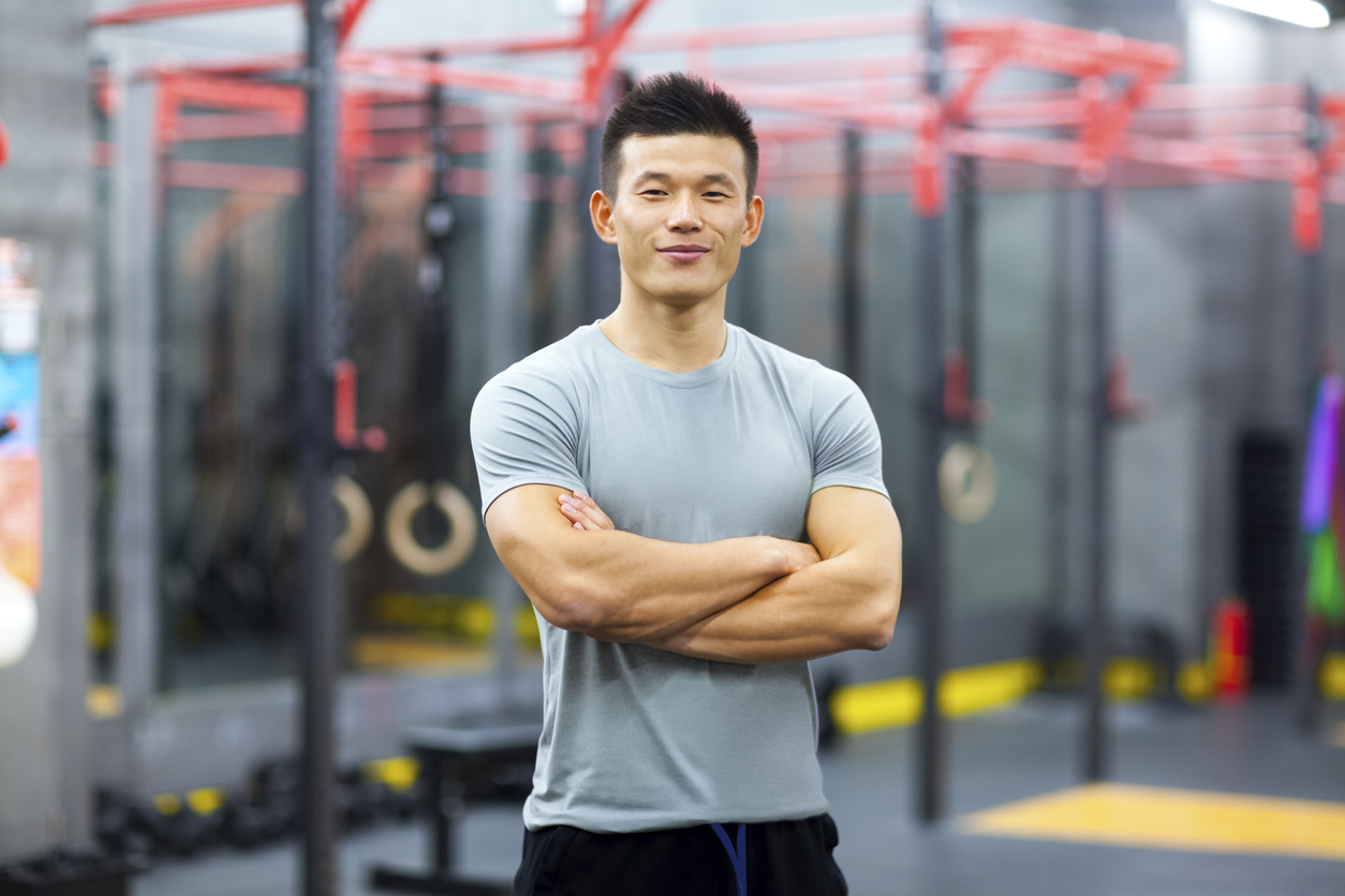 Portrait of Chinese personal trainer in gym