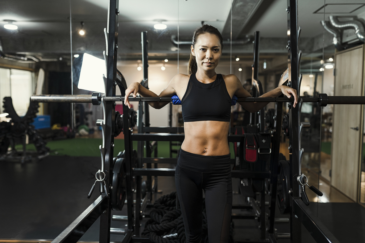 Mid adult woman training at gym
