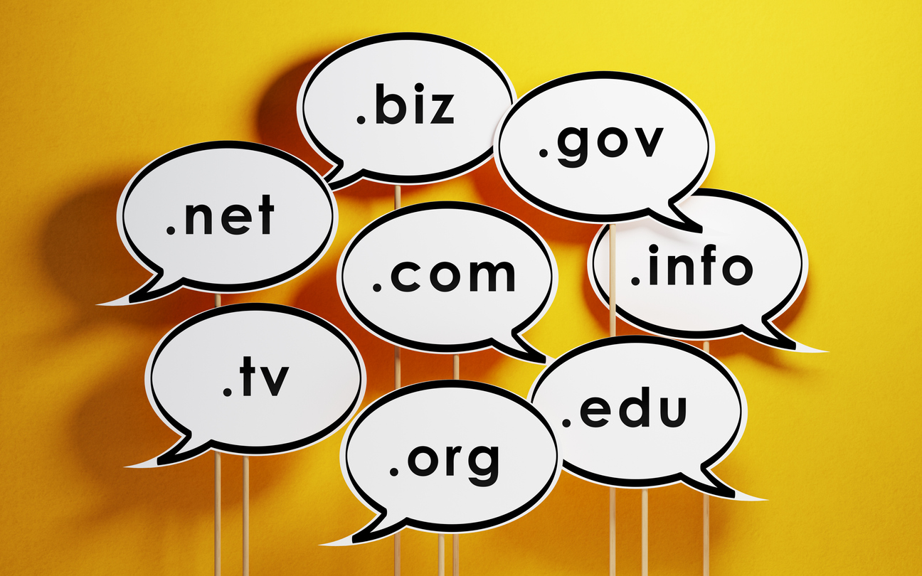Speech Bubbles With Domain Extensions On Yellow Background